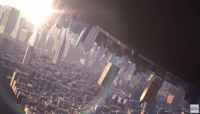 開かれたフォルダブルスマートフォンの中には都市が展開されている